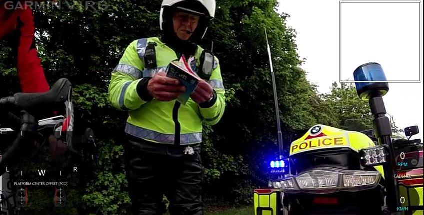 Essex motorbike cop consults Highway Code (YouTube still, user Paul Clayton).JPG