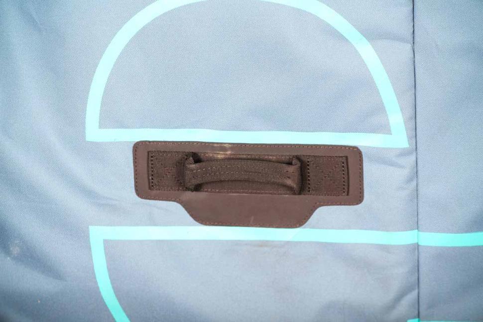 Evoc Bike Travel Bag and stand - handle.jpg