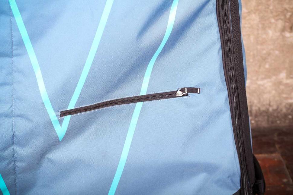 Evoc Bike Travel Bag and stand - zip pocket.jpg