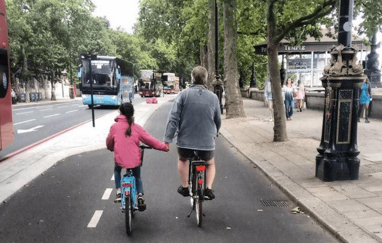 Girl holding hands with dad on Cycle Superhighway (source BikesandBabies on Twitter).PNG