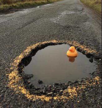huge pothole - credit shaun wyllie on facebook.PNG