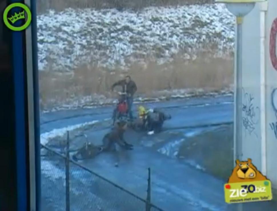 Dutch cyclists slipping on icy corner