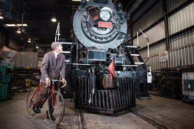 Cyclist vs steam train