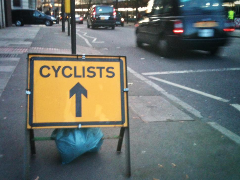 Cyclists sign and London cab (copyright Simon MacMichael)