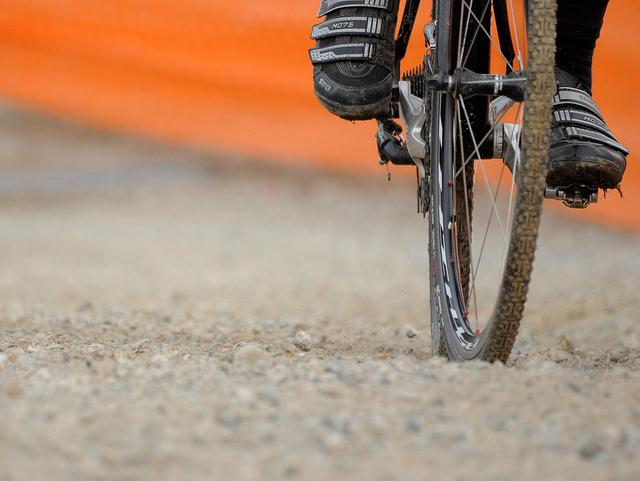 Cyclo-cross wheel and shoes (licensed on Flickr by  Musume Miyuki under CC BY SA 2.0)