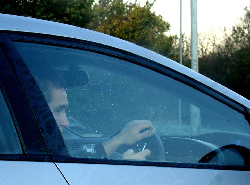 Driver using mobile (CC licensed image by lukys1:Flickr)