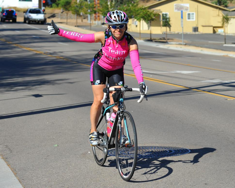 Female cyclist giving thumbs up (uploaded to Flickr under CC-BY-SA licence by Chris Hunkeler)