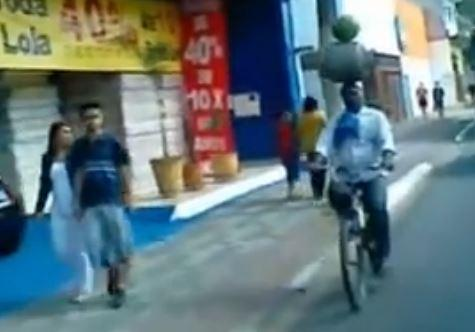 Gas canister and watermelon balancing cyclist YouTube still