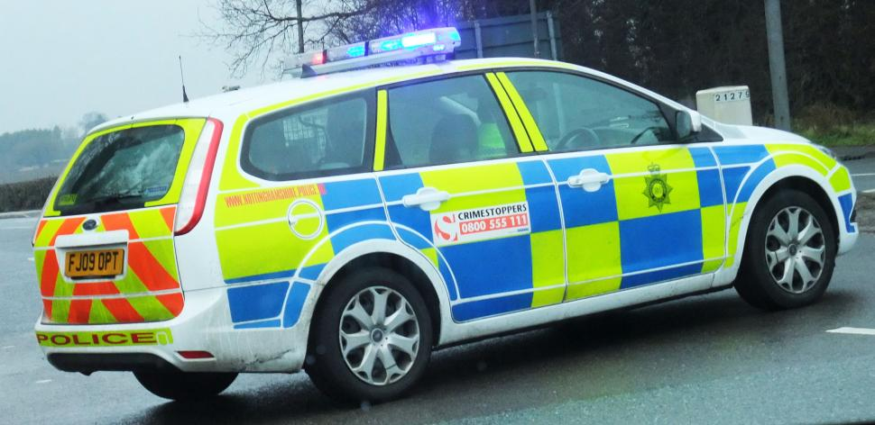 Police car flashing lights (CC licensed by Lee Haywood)