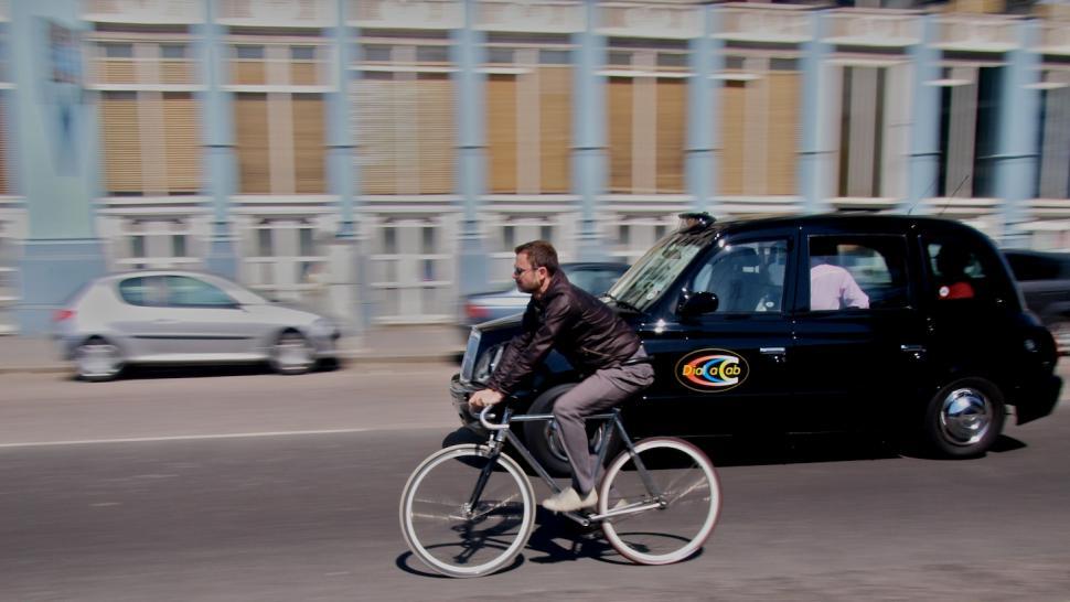 Taxi and Cyclist copyright Simon MacMichael.jpg