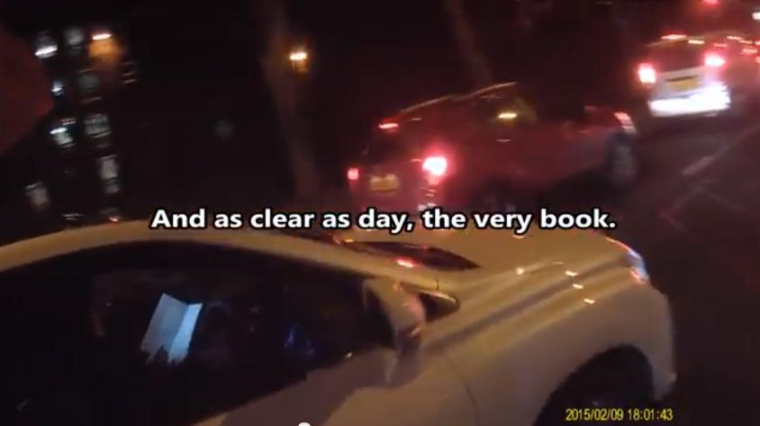 Must've been a page-turner... Woman caught on camera reading a BOOK at the wheel