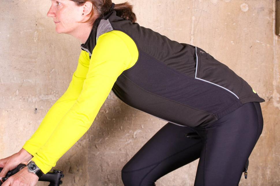 Isadore Womens Merino Membrane Soft Shell Vest - riding.jpg