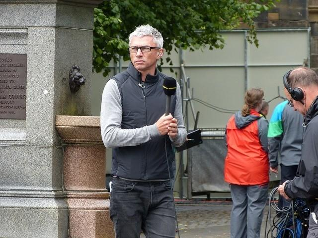 Jonathan Edwards at the 2014 women's time trial in Glasgow (CC licensed by brassyn via Flickr).jpg