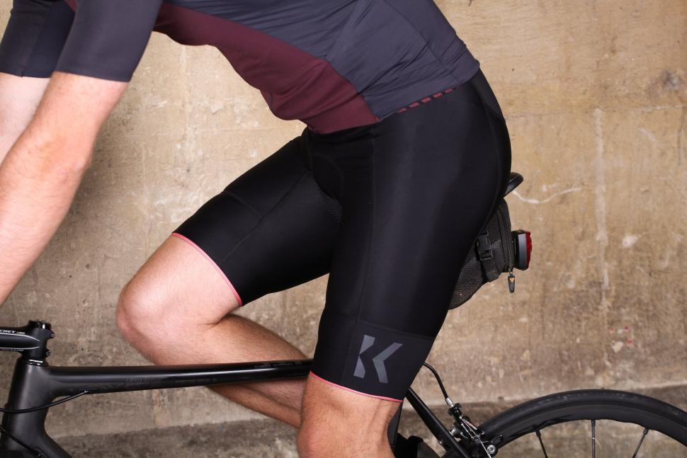 Kalf Chevron Men's Bib Short - riding.jpg