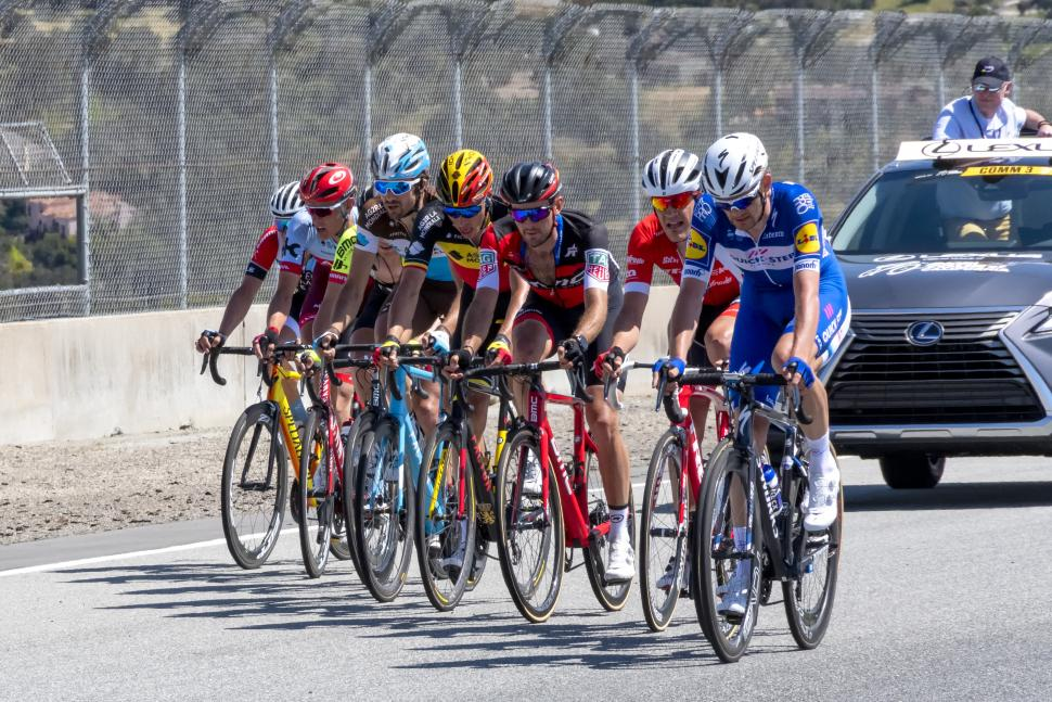 Nine_rider_echelon_followed_the_UCI_Commissaire_on_the_Rahal_Straight_at_Laguna_Seca_(42045587094)