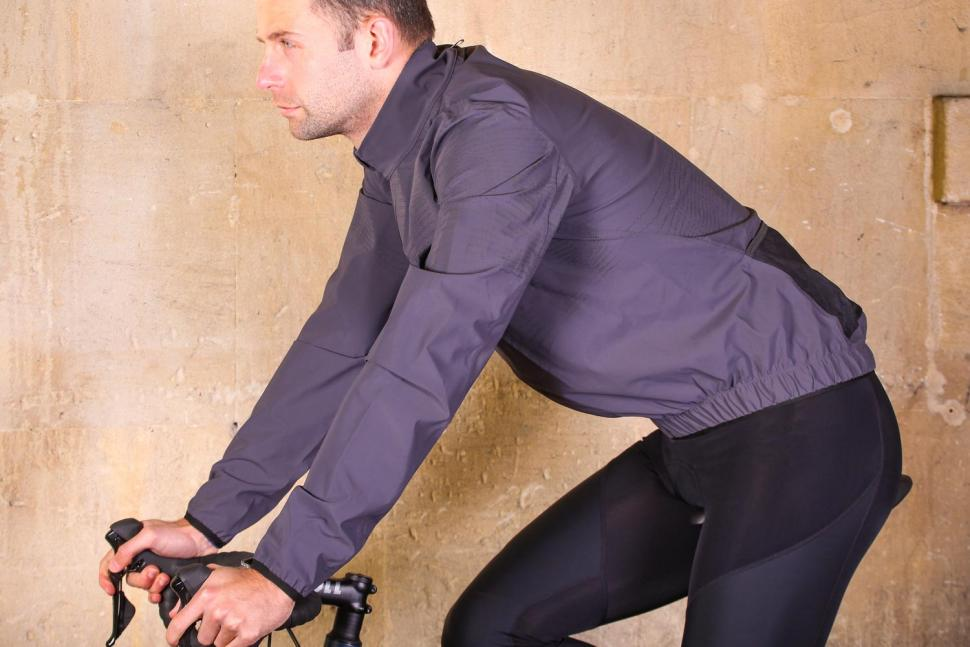PEdAL ED Hikari Reflective Shell Jacket - riding.jpg