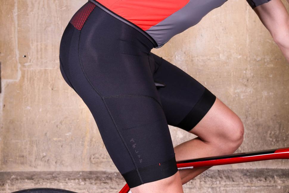 Pedal ED Odyssey Bibshorts - riding.jpg