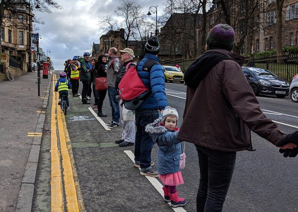 People protected bike lane in Glasgow (via GoBike on Twitter)