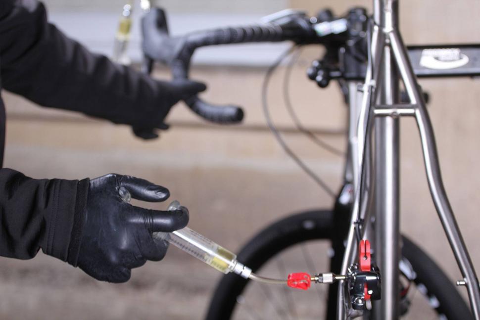 pressure calliper and slowly release lever.jpg