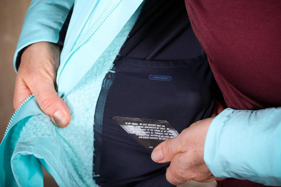 Rapha Souplesse Insulated Jacket - pocket and head phone slot.jpg