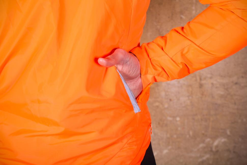 Rivelo Newington Reversible Jacket orange - pocket.jpg