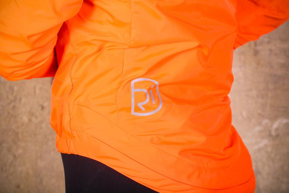 Rivelo Newington Reversible Jacket orange - reflective logo.jpg