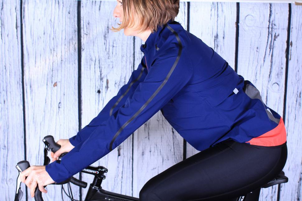 Rivelo Womens Larkstone Jacket - riding.jpg