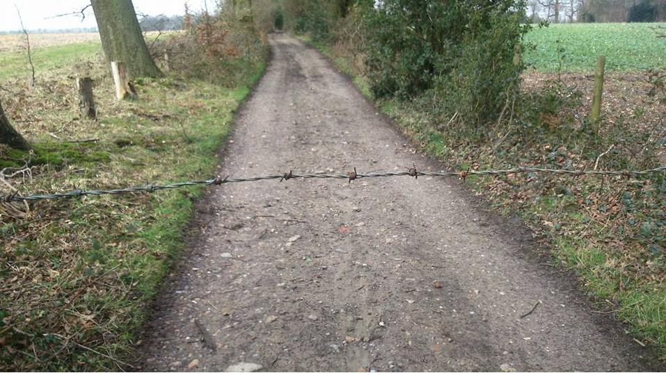 Barbed wire on bike path Kent