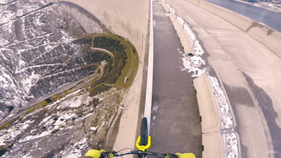 Fabio Wibmer atop Austria's Koelnbreinsperre dam (still from YouTube)