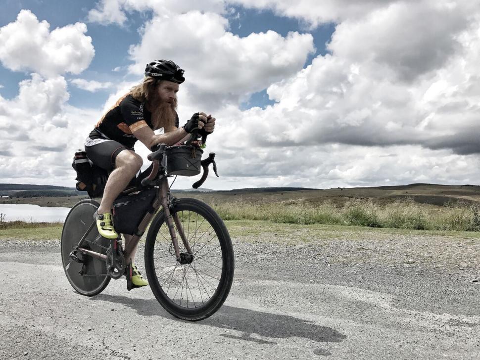 Sean Conway riding.jpg