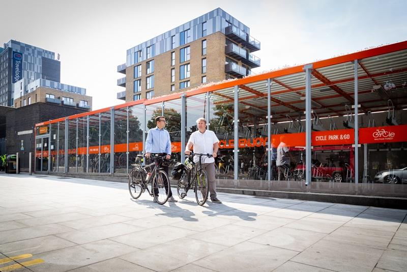 Will Norman and Cllr Clyde Loakes at a cycle parking hub in Walthamstow (TfL)