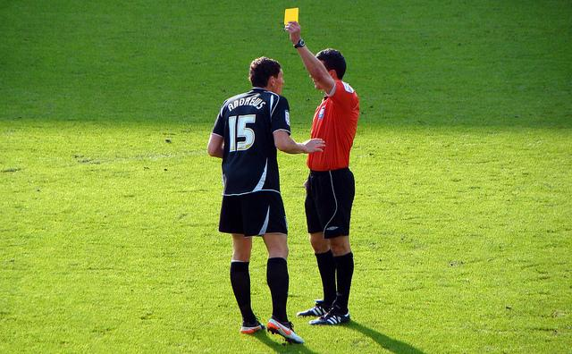 Yellow card (licensed CC BY-SA 2.0 on Flickr by Jon Candy).jpg