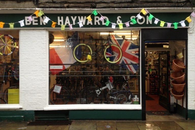 Ben Hayward & Son's former Trumpington St premises decked out for Tour de France 2014 Stage 3 start in Cambridge (source Facebook).jpg