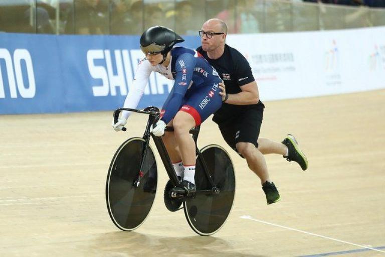 British Cycling sprint coach Jan van Eijden gives a helping hand at 2017 World Championships (copyright Britishcycling.org,uk).jpg
