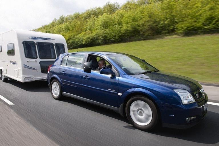 Car towing caravan - Licensed CC BY-2.0 by Highways England on Flickr.jpg