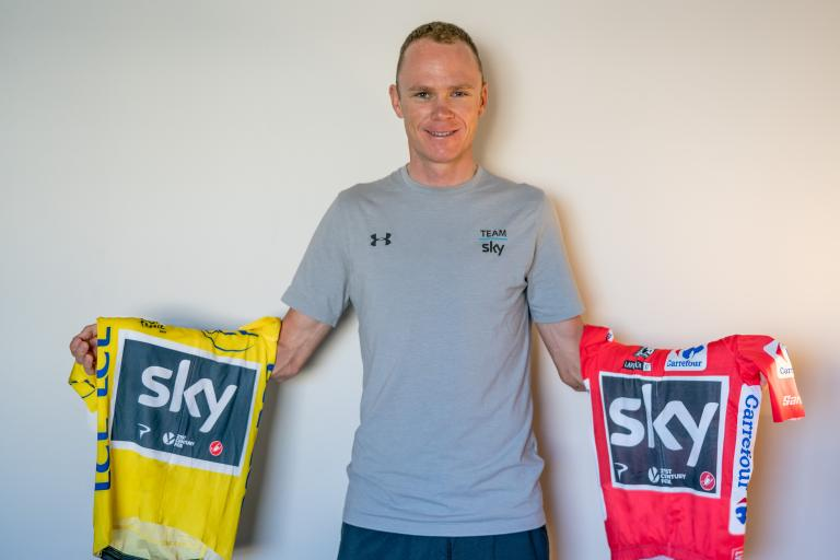 Chris Froome with Tour de France and Vuelta winner's jerseys.jpg