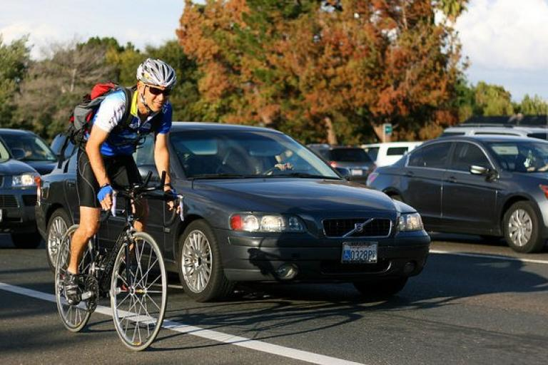 Cyclist and cars - image via Richard Masoner on Flickr.jpg