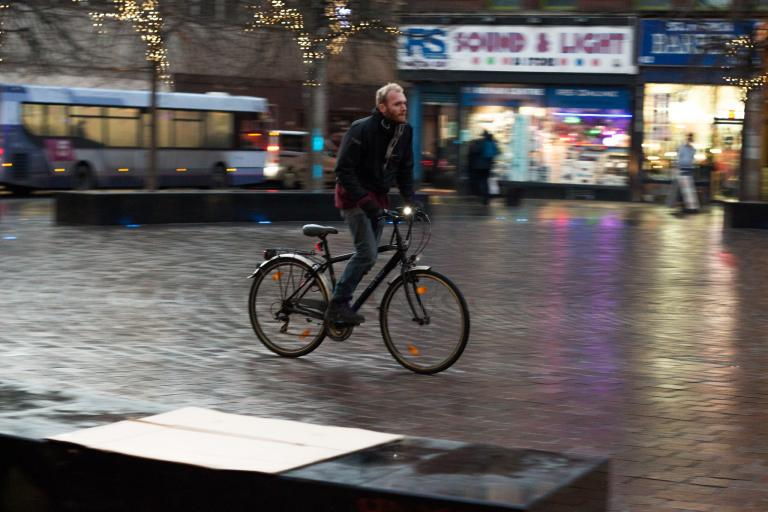 Cyclist riding through pedestrian area - image via Graeme Paterson on Flickr.jpg
