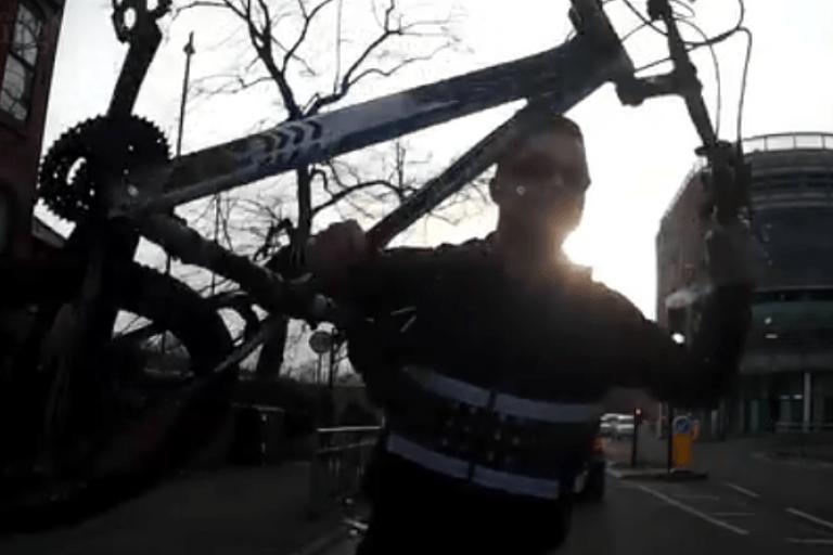 Cyclist smashes car windscreen dash-cam footage still.PNG
