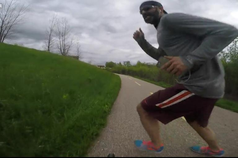 Cyclist collides with headphone wearing runner - image via LiveLeak