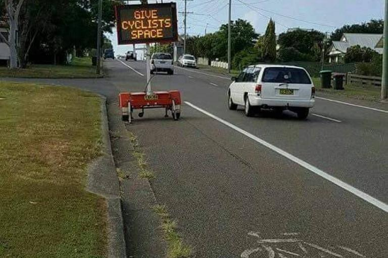 Give Cyclists Space sign in bike lane Sydney (source Matt Howell on Facebook).jpg