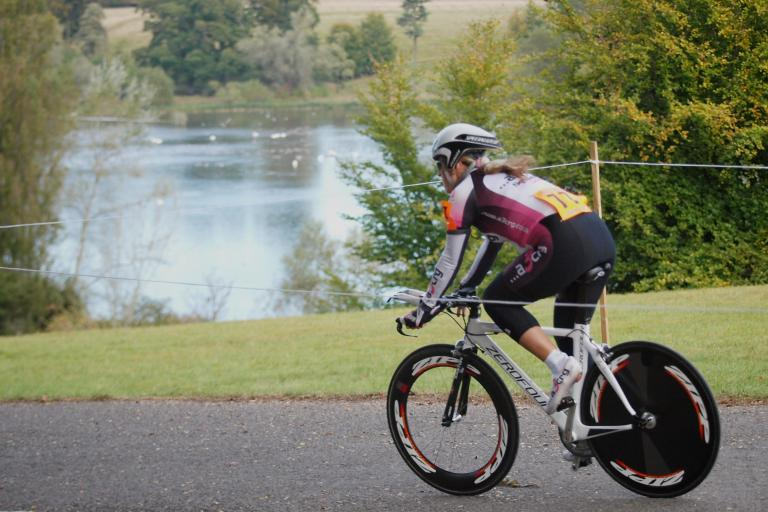 Competitor passes the lake  in the Bike Blenheim Palace women's time trial