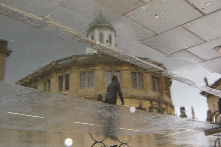 Bike passing Sheldonian Theatre, Oxford.jpg