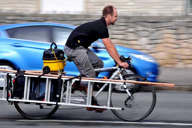 Plumber Chris Jones on his bike (picture credit Dorset Media Service).jpg