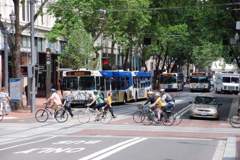 Portland_Transit_Mall_with_cyclists_crossing.jpg