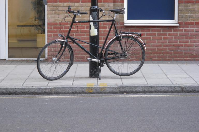 Tall person requires a tall bike