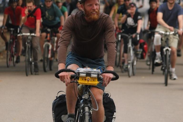 Cyclists escort James Bowthorpe into Hyde Park at the end of his record-breaking round-the-world trip