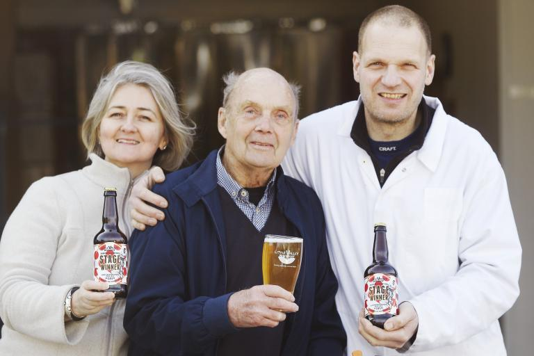 Brian Robinson Tdf stage winner with Stage Winner brewers Sue Cooper and Wim van der Spek (image courtesy of Fcomms)