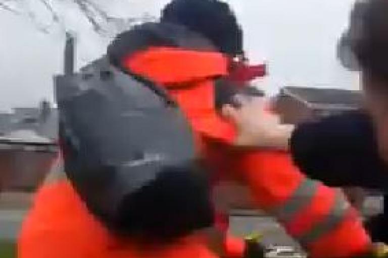 Car occupant pushes cyclist off bike Facebook video still