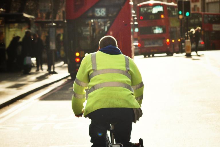 Cyclist and London buses (copyright Simon MacMichael)